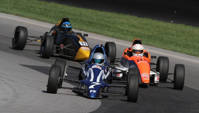 Drivers raced their vehicles around the Mid-Ohio Sports Car Course on Tuesday in the second day of qualifying for the SCCA National Championship Runoffs.