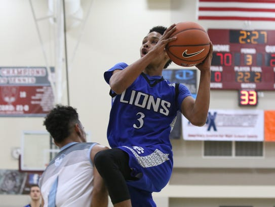 Cathedral City's T'Shaun Toussaint shoots the ball