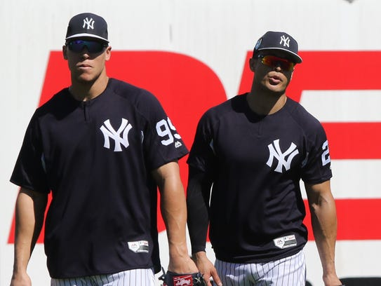 Aaron Judge and Giancarlo Stanton, both in left field