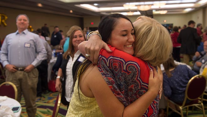Reitz High School senior Abby Mueller, center, is congratulated by her teacher and mentor, Lynn Arteberry, after being named the 2017 Youth Resources Youth of the Year at the Hall of Fame Celebration at the Holiday Inn Wednesday morning.