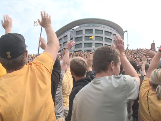 Iowa Hawkeye fans wave to kids in the children's hospital