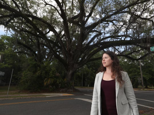 Mindy Mohrman, Tallahassee's Leon County urban forester stands for a portrait downtown amongst the green landscape that is a signature of the capital city.
