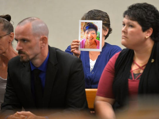 Tammie Duprey of Barre, Vt., holds up a photo of her deceased neighbor, Cindy Cook, during the arraignment of Randal Gebo on Monday, Aug. 28, 2017, in Barre. Gebo was arraigned on a murder charge arising from the killing of Cook, whose body was found July 12 near a brook in Middlesex.  Gebo pleaded not guilty to first-degree murder charges.