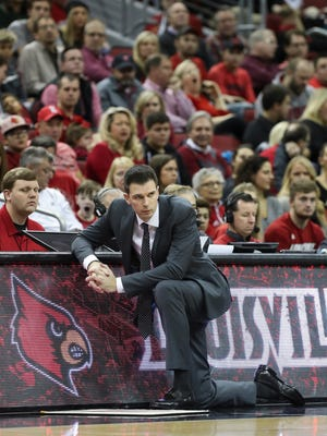 U of L's head coach David Padgett watched action against Boston College during their game at the KFC Yum! Center.  