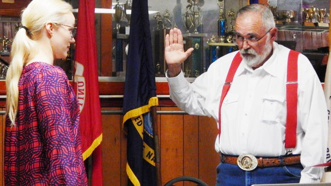 Grace Jones with the SREC-20 swears in Charlie Ragland as the Jim Wells County Republican Chairperson.