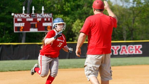 Tappan Zee's Nicole Spiegelberg (16) gets a high-five