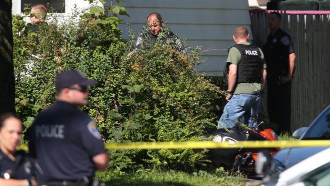 Police investigate a fatal shooting on Otis Street.