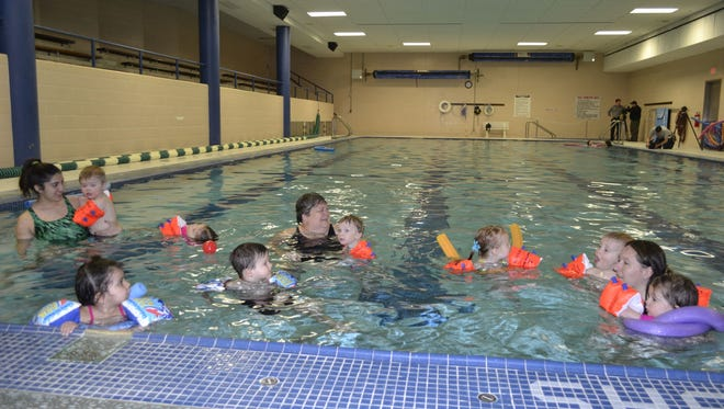 Children ages 2-3 and their instructors enjoy the water during their swimming class Tuesday morning in the lap pool at the YWCA of Greater Green Bay.