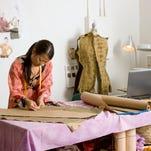Fashion designer in her workshop.