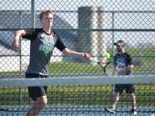 James Buchanan's Isaac Shenton hits the ball against Bishop McDevitt in a Mid Penn Colonial Division match on Wednesday, Aptil 12, 2017.
