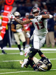 Tampa Bay Buccaneers wide receiver Mike Evans (13) carries against New Orleans Saints cornerback Marshon Lattimore (23) in the second half of an NFL football game in New Orleans, Sunday, Sept. 9, 2018. (AP Photo/Butch Dill)