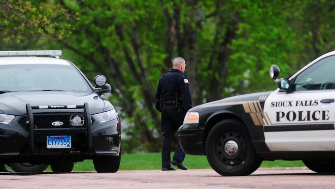 Sioux Falls Police officers are shown on the scene where two juveniles  were arrested on Monday near the corner of South Bahnson Avenue and South Comet Road in Sioux Falls.