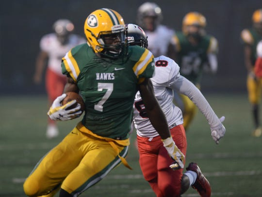 Harrison's Ovie Oghoufo runs for yard after catching a pass during the first half.