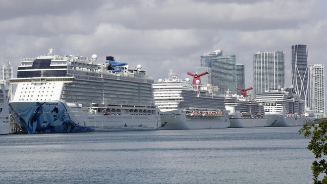 Cruise ships docked at PortMiami on March 31, 2020.
