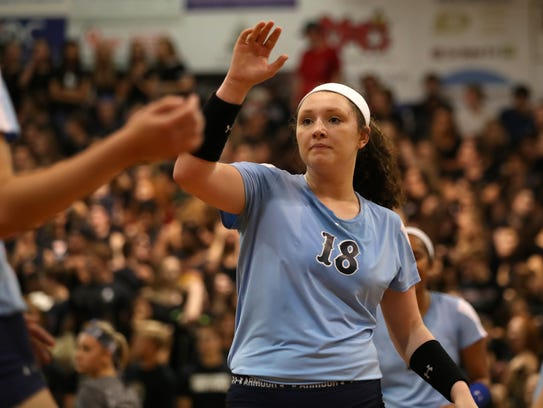 Maclay's Madison Evans high fives a teammate during