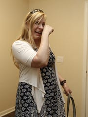 Michele Lammers becomes emotional as she walks into her new home for the first time in West Des Moines.