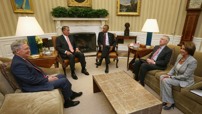 Obama meets with McConnell, Boehner, Reid and Pelosi in the Oval Office on Sept. 9, 2014.