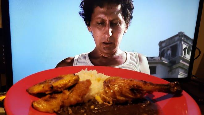 "Alexis Diaz de Villegas as Juan in ""Juan de los Muertos"" (Juan of the Dead) pairs with roasted chicken and rice and beans."