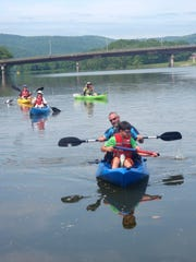 Paddlers float down the Chemung River.