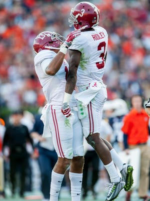 Alabama wide receiver ArDarius Stewart (13) and wide receiver Calvin Ridley (3) celebrate a Ridley catch against Auburn during the Iron Bowl at Jordan-Hare Stadium in Auburn, Ala. on Saturday November 28, 2015. (Mickey Welsh / Montgomery Advertiser)