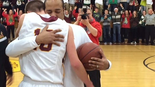 Jake Zeitler (10) embraces Luxemburg-Casco boys basketball coach John Hampton after scoring his 1,000 point Friday night.