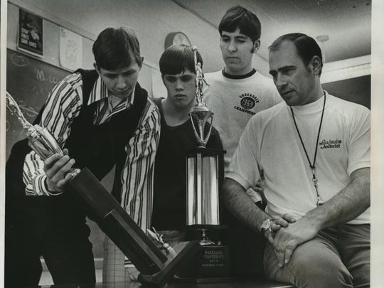 Greendale High School basketball coach Ron Barbian and three of his top players posed in 1971 with the trophies the team has won in the previous two years as Parkland Conference king-pins. Greg Hammer held one of the trophies as Tom Joyce and Bob Revers looked on.