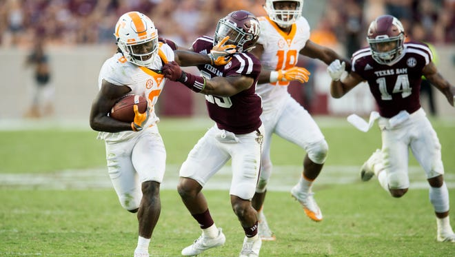 Tennessee running back Alvin Kamara (6) tries to fight off Texas A&M defensive back Amari Watts (23) during the second half of the game on Saturday, October 8, 2016. (SAUL YOUNG/NEWS SENTINEL)