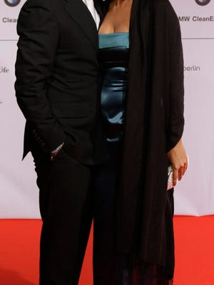 U.S. actor Joseph Fiennes, left, and his partner Maria Dolores Dieguez arrives at the 'Cinema For Peace' gala in Berlin, Germany, Monday, Feb. 11, 2008.  (AP Photo/Miguel Villagran) ORG XMIT: MSC176