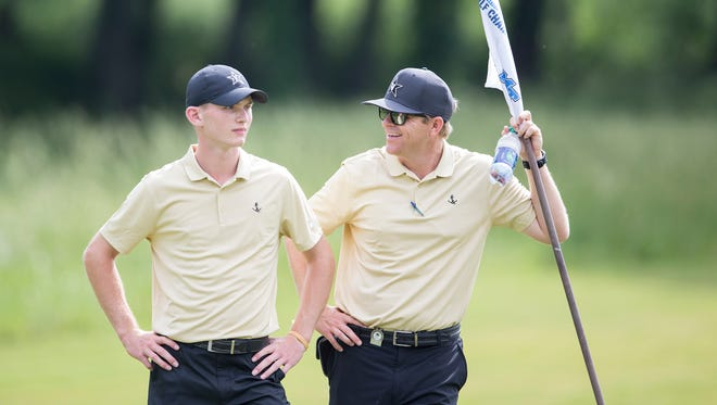 Vanderbilt coach Scott Limbaugh, right, shares a light moment with golfer Patrick Martin during the NCAA Regional in College Grove.