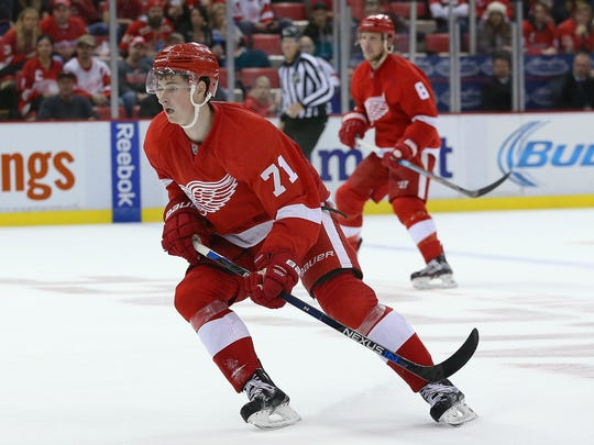 Dylan Larkin (front) cruises into an opponent's zone