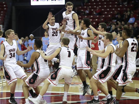 Stevens Point High School players rush the court following their 85 to 56 victory over Arrowhead High School during their Division 1 WIAA state basketball championship game on Saturday, March 18, 2017 at the Kohl Center in Madison, Wis. Wm. Glasheen/USA TODAY NETWORK-Wisconsin