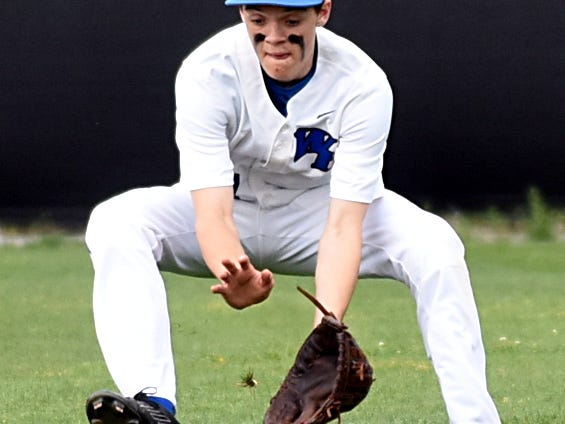 White House High sophomore rightfielder Kevin James fields a first-inning ground ball during Monday's first game.