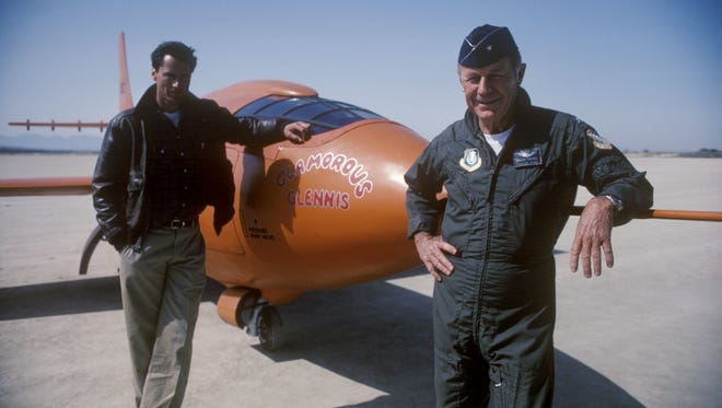 Sam Shepard as Chuck Yeager, and Chuck Yeager in front of 'Glamorous Glennis.'