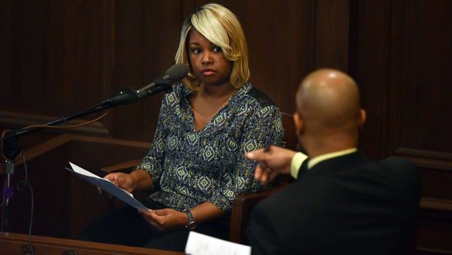 Kwanza Hilliard, Christopher Butler's ex-girlfriend, hesitates in answering several questions by Assistant Attorney General Marvin Sanders during the proceedings of the criminal trial against Hinds County District Attorney Robert Smith in Jackson Tuesday.