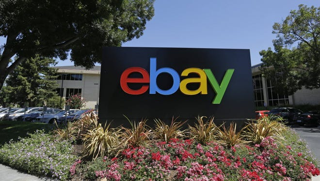 This July 16, 2013 file photo shows an eBay sign at eBay headquarters in San Jose, Calif.