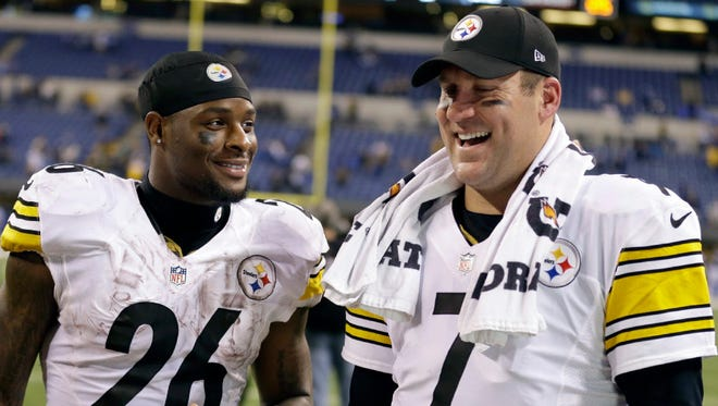 In this Nov. 24, 2016, file photo, Pittsburgh Steelers quarterback Ben Roethlisberger (7) and running back Le'Veon Bell (26) talk following an NFL football game against the Indianapolis Colts, in Indianapolis.