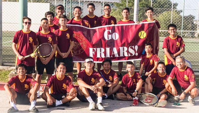 The Father Duenas Friars edged the Harvest Christian Academy Eagles in a tiebreaker to win their fourth straight IIAAG Tennis title. They are show here standing, from left: Tyler Talai, Simeon Delos Santos, Ryoh Sato, Alvin Almira, Eddie Chung, Jonathan Lee, Roy Manaloto, Joshua Sanchez, Andrea Dasalla, Jose Manaloto, and Nathaniel Liwanag. Kneeling from left, are:  Gabriel Tan, Camden Camacho, Danny Kwon, Byron Blas, Aaron Gumataotao, Jason Milan, Ronald Lin and  Coach Dan Tinsay. Not pictured is Youngjin Cheon.