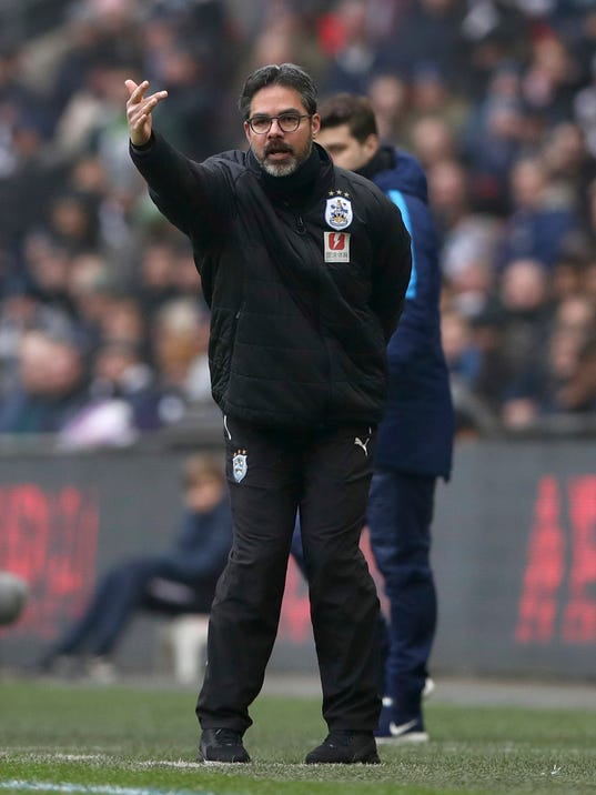 Huddersfield Town manager David Wagner gestures on the touchline during the match against Tottenham Hotspur during their English Premier League soccer match at Wembley Stadium in London, Saturday March 3, 2018. (John Walton/PA via AP)