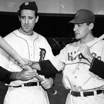 In this Oct. 4, 1945, file photo, Detroit Tigers leftfielder Hank Greenberg, left, and Chicago Cubs first baseman Phil Cavaretta talk before Game 2 of the World Series in Detroit.