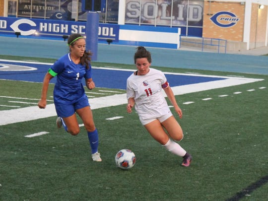 Carlsbad senior Gabby Aragon chases down a Las Cruces player during Tuesday's game.
