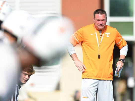 Tennessee football coach Butch Jones watches practice