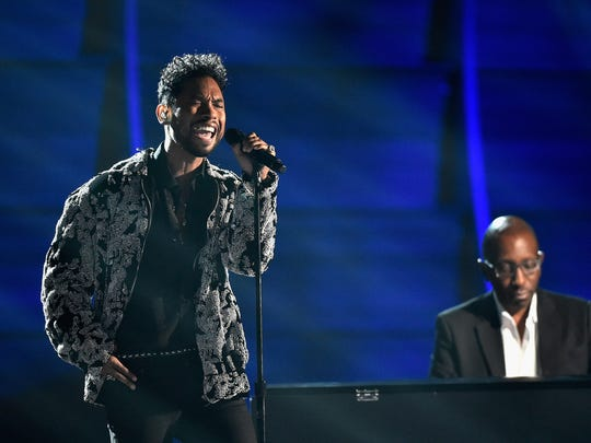 Miguel (L) and musician Greg Phillinganes perform onstage