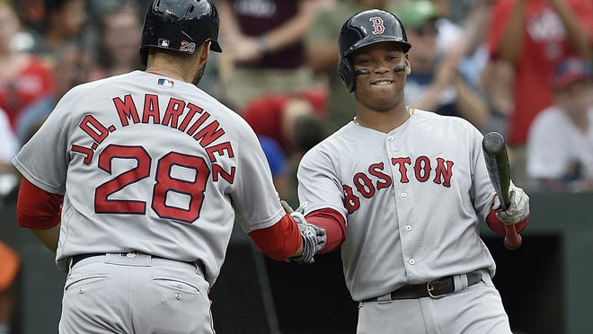 With a drastically shortened season, Red Sox sluggers J.D. Martinez, Rafael Devers, right, and Xander Bogaerts could heat up at the plate and make Boston a threat in the American League, even without former MVP Mookie Betts.