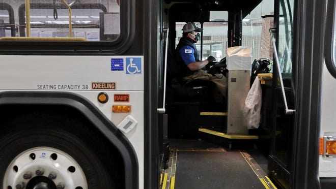 Bus driver, Tony Sousa, prepares to drive his bus from the New Bedford SRTA bus terminal.