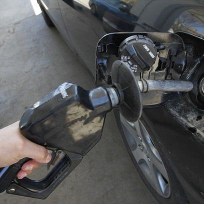 Motorist pumps gas in Rochester.