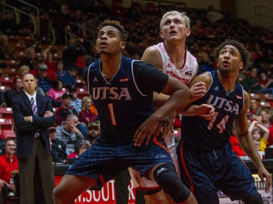 SUU's Race Parsons fights for a rebound in the game against UTSA, Saturday, Nov. 21, 2015.