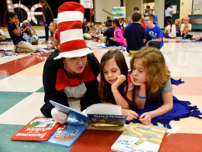 Amy Reese, dressed as The Cat in the Hat, reads to