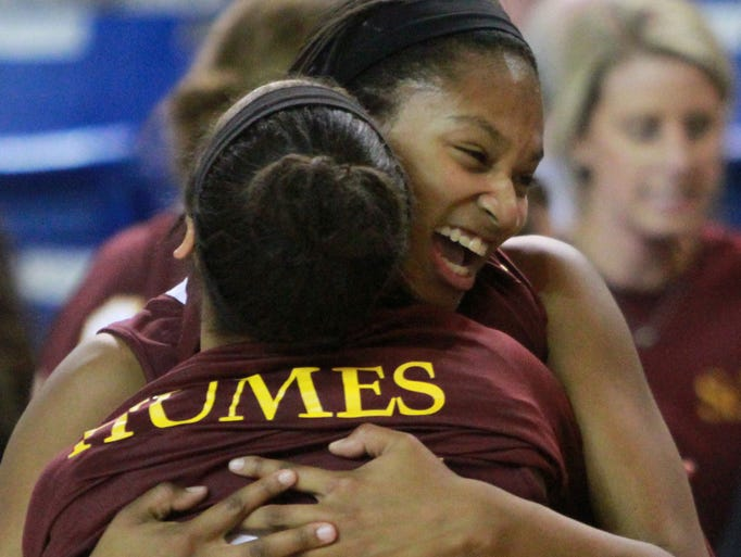 St. Elizabeth's Alanna Speaks (right) hugs teammate Jordyn Humes at the end of the Vikings' 55-38 win against Ursuline in a semifinal of the DIAA state high school tournament Wednesday, March 5, 2014.