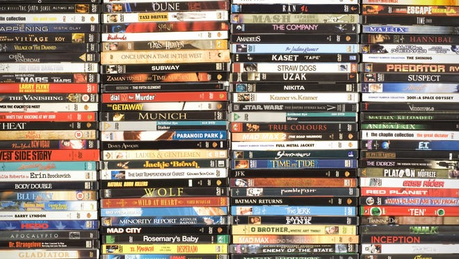 A Bellmawr postal worker had a sideline -- pirating DVDs and selling them. Now he faces fines and possible jail time.