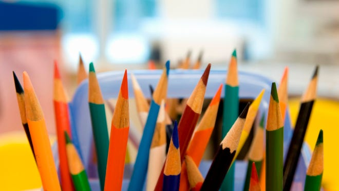 Stock photo: Large assortment of multi-colored pencil crayons.